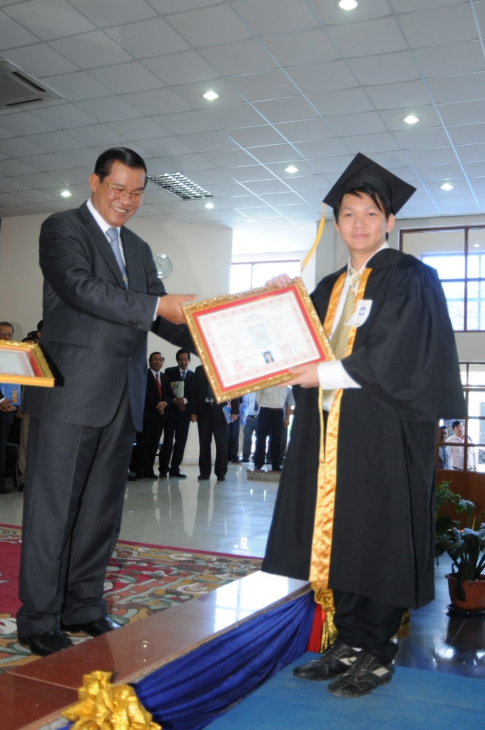 With My Cambodia Prime Minister H.E. Samdech Hun Sen. Graduated with honors